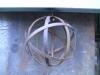 metal-strap-globe-hanging-light-industrial-looking-bulb-cage-lantern-2
