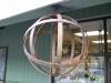 metal-strap-globe-hanging-light-industrial-looking-bulb-cage-lantern-7